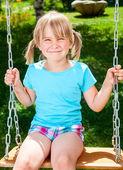 Happy child on swing — Stock Photo