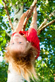 Child hanging from tree — Stock Photo