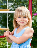 Happy girl on jungle gym — Stock Photo