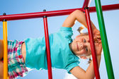 Happy child on jungle gym — Stock Photo