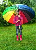 Child with umbrella outdoors — Stock Photo