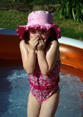 Young girl in pool — Stock Photo