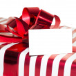 Christmas Present with Ribbon and tag. Isolated on white backgro — Stock Photo