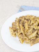 Italian penne pasta with chopped meat — Stock Photo