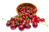 Cherry in wooden bowl isolated on white background — Stockfoto