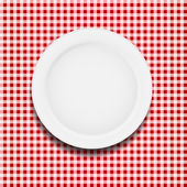 White plate on a checkered tablecloth vector illustration — Stock Vector