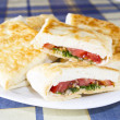 Pita bread with cheese, tomato and herbs — Stock Photo