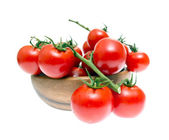 The Branch of Cherry Tomatoes in a Wooden Bowl — Stock Photo