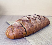Fresh Tasty Bread on Woody Background — Stock Photo