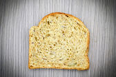 Fresh Tasty Bread on Woody Background — Stock Photo