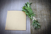 Rosemary Bound on a Wooden Board Background. Lots of copy space. — Stock Photo