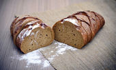 Fresh Tasty Bread on Woody Background — Foto Stock