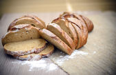 Fresh Tasty Bread on Woody Background — Stock fotografie