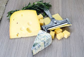 Cheese on Wooden Background — Stock Photo