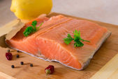 Salmon fillet on wooden background . — Stock fotografie