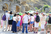 Tour Guide with Tourists on the Ruins — Stock Photo