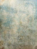 Grunge wall of a background in scratches — Stock Photo