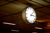 Public clock In a railway station — Stock Photo