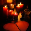 Romantic love letter in shape of broken heart (teared paper) with candles and old perfume bottle and pen. — 图库照片 #13462362