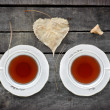 Autumn tea for two in vintage white cups on wood — Stock Photo