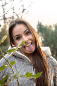 Young female making funny face with tongue out — Stock Photo