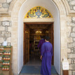 Pilgrims buying wine made in monastery - Stock Photo