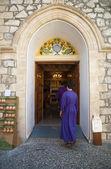 Pilgrims buying wine made in monastery — Stock Photo