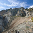 New road and afforestation of old quarry in the mountains — Stock Photo