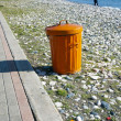 Stock Photo: Orange dustbin on beach alley