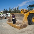 Stock Photo: Womin massive excavator bucket