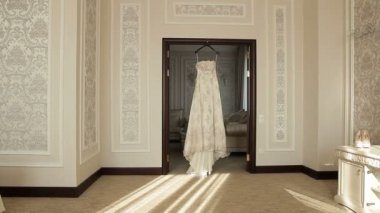 Honeymoon Room, filled with light. In the doorway hanging bride's wedding dress — Stock Video