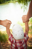 In Parents Hands — Stock Photo