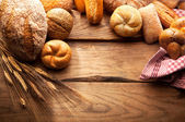 Variety of Bread on wooden table — Stockfoto