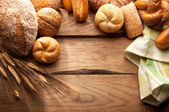 Variety of Bread on wooden table — Stock Photo