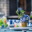 Dining outside in spring - Stock Photo