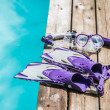 Diving goggles, snorkel and fins on the jetty — Stock Photo