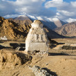 Buddhist stupas near the Shey monastery against the Himalayas mo - Stock Photo