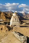 Buddhist stupas near the Shey monastery against the Himalayas mo — Stock Photo