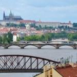 View of Prague Castle across the swollen river Vltava — Stock Photo