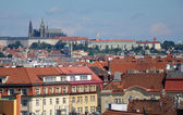 View of Prague Castle over the roofs of city buildings — Stockfoto