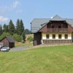 SUMAVA - JUL 19: Typical mountain house — Stock Photo