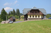SUMAVA - JUL 19: Typical mountain house — Stock Photo