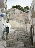 The narrow street and stairway between the houses, Italy — Stock Photo