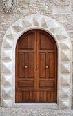 A massive medieval door — Stock Photo