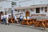 PESCHICI - SEP 11: Paposceria - restaurant only for men — Stock Photo