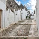 Street in the southern Italian town of Alberobello — Stock Photo #42470485