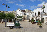 A typical Italian piazza in Alberobello town — Stock Photo