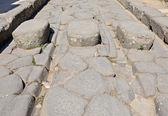 Original ruts in the stone road in Pompeii — Stock Photo