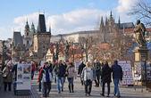 PRAGUE - FEB 23: Tourism on the Charles Bridge — Stock Photo