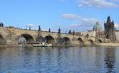 PRAGUE - FEB 23: Tourist boat sailing under the Charles Bridge — Stock Photo